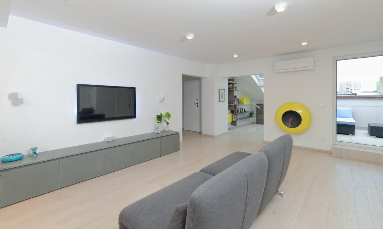 modernes wohnzimmer mit grauem sofa bauen und wohnen in der schweiz. Black Bedroom Furniture Sets. Home Design Ideas